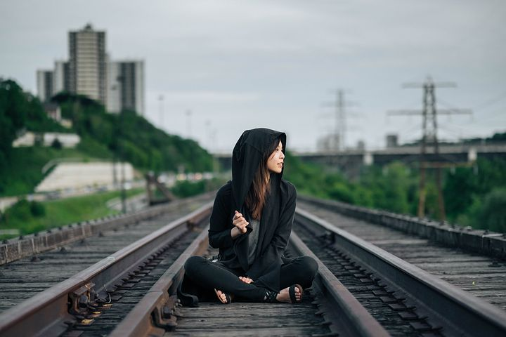 Girl sitting on railway track sad images for whatsapp dp