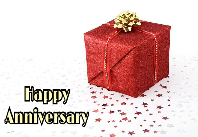 Happy anniversary image with gift