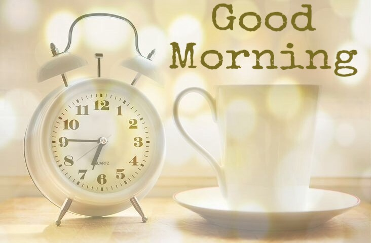 Good morning image with alarm clock and coffee cup